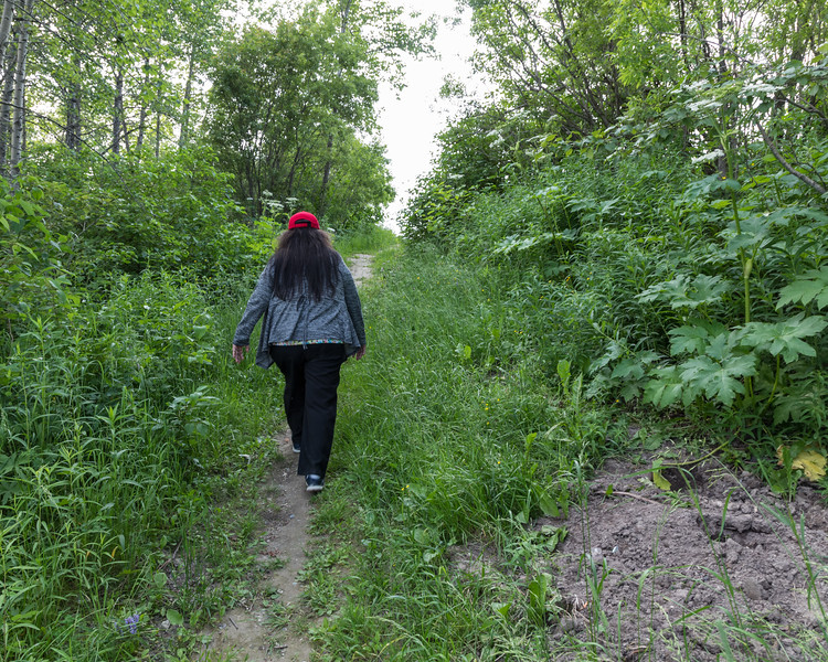 Denise Lantz heading up a path from Store Creek.