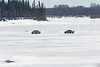 Trucks driving on the Moose Rivere 2017 March 31st.