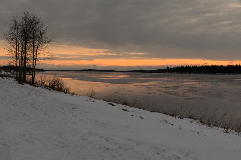 Moose River shoreline in Moosonee before sunrise.