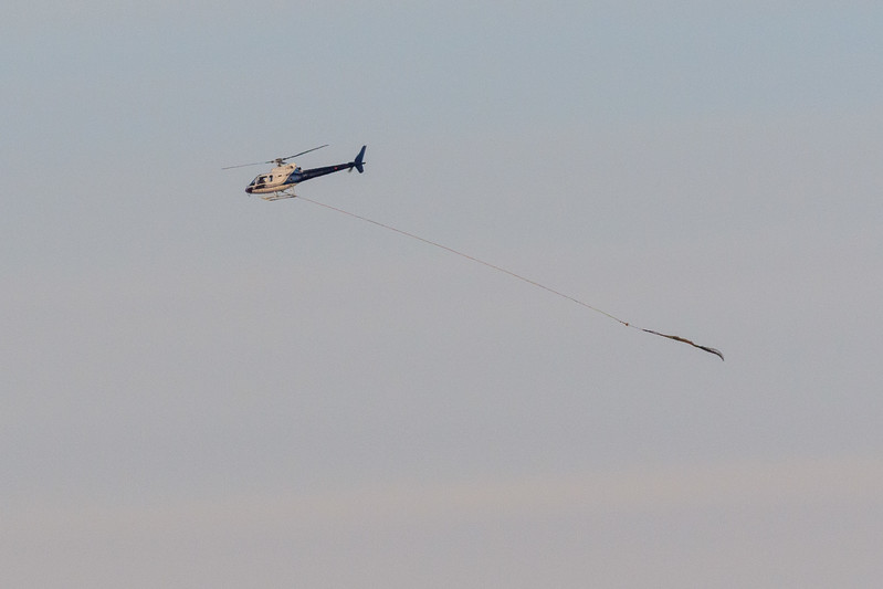 Helicopter returning to Moosonee from Moose Factory with an empty sling.