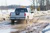 The muddy streets of Moosonee. Revillon Road.