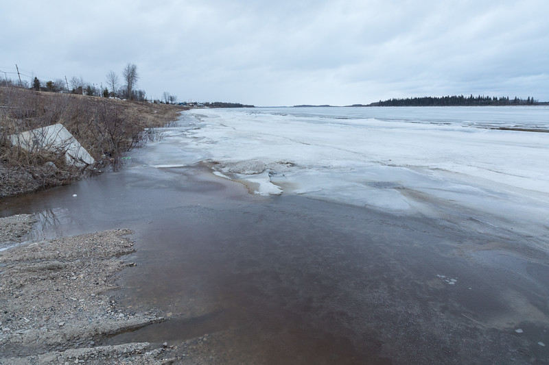 Moose River shoreline in Moosonee. Looking down the river from Two Bay docks 615 am 2017 April 29th.