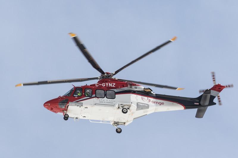 ORNGE ambulance helicopter C-GYNZ over Moosonee 2017 April 16th.