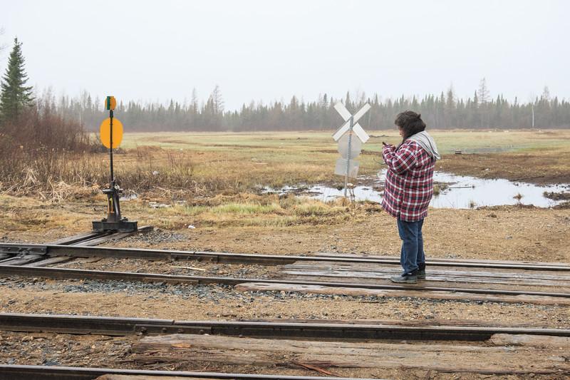 Denise Lantz waiting for the train at start of winter road.