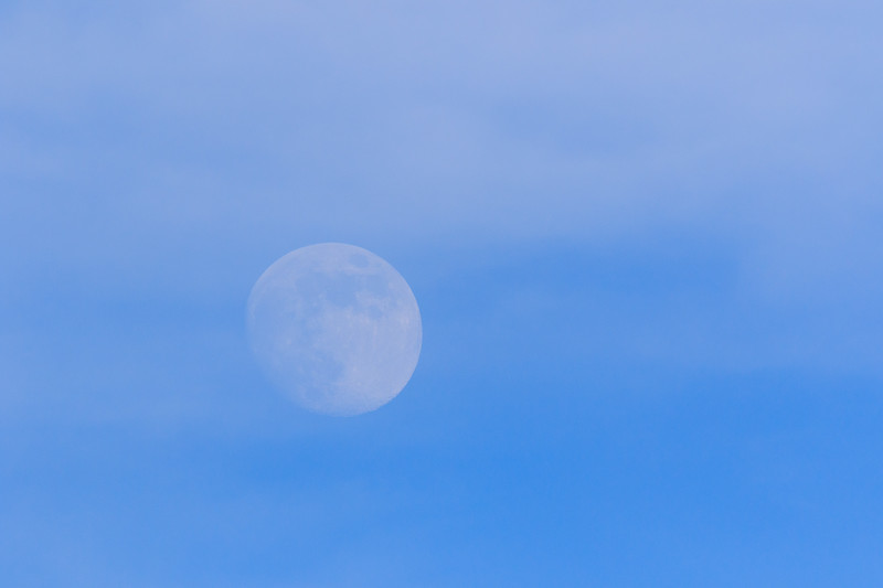 Moon heading back into the clouds.