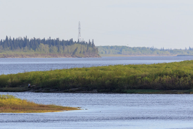 Looking up the Moose River from Moosonee. Light on hydro tower to east.
