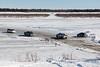 Traffic on the winter road between Moosonee and Moose Factory.