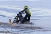 Snowmobile going through water on the Moose River.