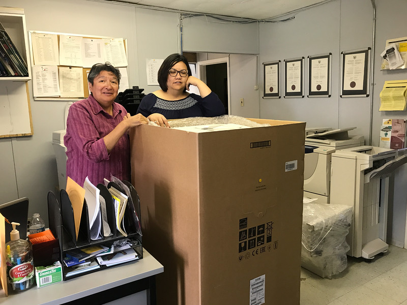 Celine Koostachine and Kathryn Hookimawillene with new photocopier 8030 in its box 2017 August 9th