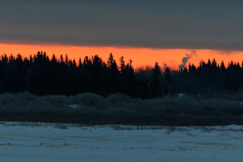 Thin band of colour along the horizon at sunrise across the Moose River from Moosonee. 2017 January 17th.
