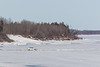 Car driving across the Moose River 2017 April 2nd.