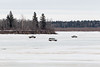 Two pickup trucks and a van driving on the Moose River near south end of Butler Island 2017 March 27th.