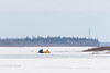 Snowmobile and sled on the Moose River at Moosonee 2017 April 20th.