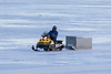 Snowmobile on the Moose River not encountering much water.
