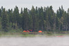 Fog drifts up the Moose River on a cool July morning at Moosonee.