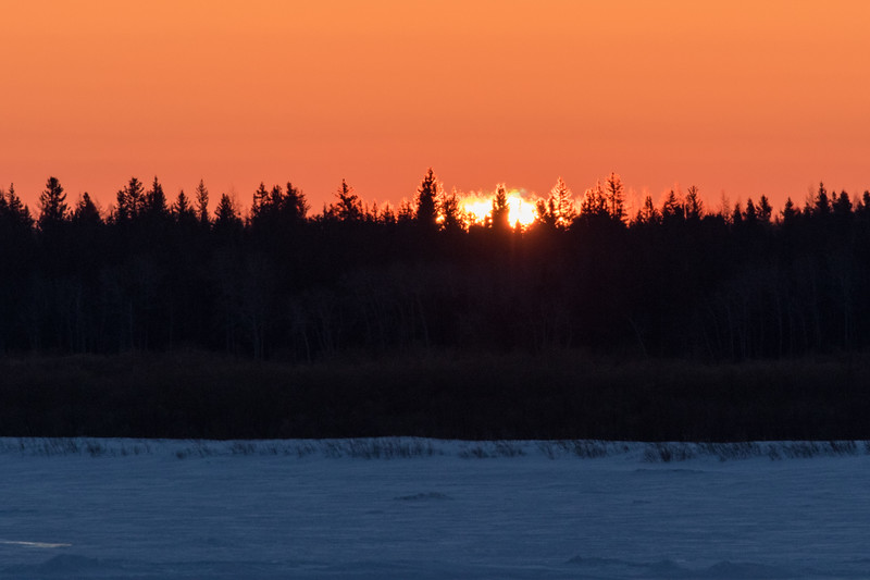 Hints of sunrise across the Moose River from Moosonee. 2017 March 5th.