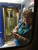 Denise Lantz between cars on the train eager to get off in Moosonee 2017 April 12th