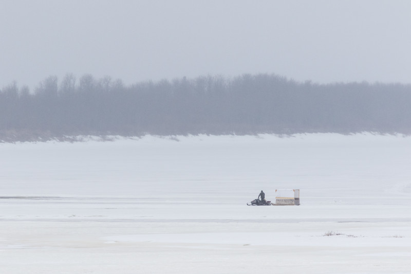 Snowmobile taxi on the Moose River in light hail or snow 2017 April 15th.