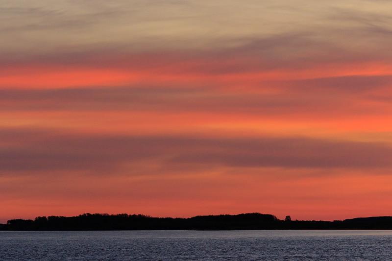 Pink and purple skies down the Moose River from Moosonee.