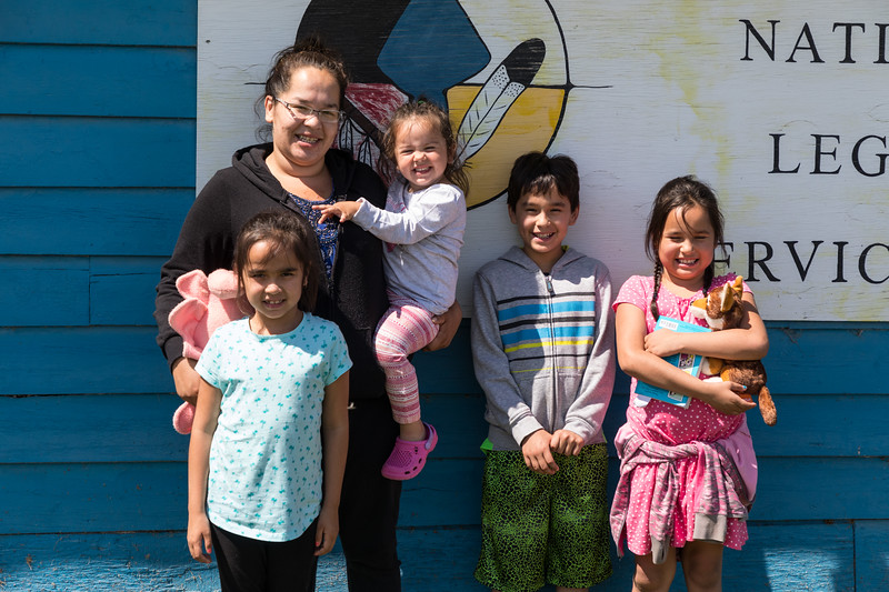 Heather Nootchtai and her children visiting at Keewaytinok Native Legal Services