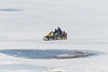 Snowmobile along the edge of the Moose River.
