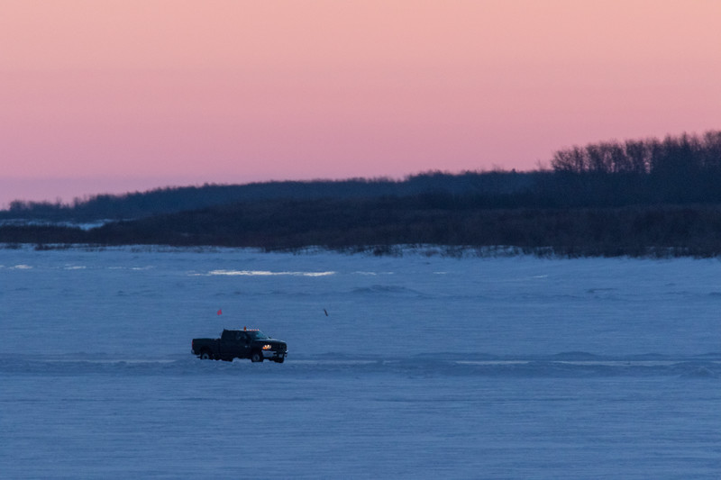 Truck on the Moose River at Moosonee before sunrise. 2017 March 5th.