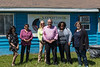 Ontario Housing Minister Chris Ballard at Keewaytinok Native Legal Services in Moosonee with Articling Student Ruchi Punjabi, Interpreter Celine Koostachin, Assistant Deputy Minister Karen Glass, Advisors Camille Gooden and Theresa Lubowitz.