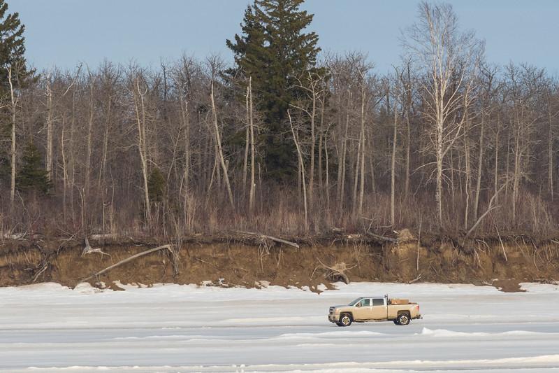 Pickup truck driving to Moosonee on the Moose River.