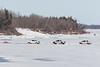 Three trucks on the Moose River near Airport Road in Moosonee.