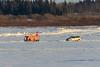Scissors lift driving across the Moose River 2017 February 1st.
