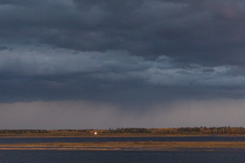 Looking across the Moose River on a storm promising evening.