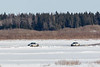 Two police trucks on the Moose River 2017 April 2nd.