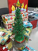 Christmas tree amid gifts in library