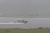 Hospital boat in the rain on the Moose River.