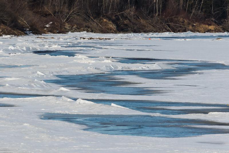 Broken ice along the Moose River tidemark at Moosonee.
