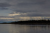 Clouds over the north end of Butler Island in the Moose River at Moosonee, Ontario. Dark shot
