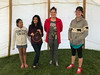 Articling student Ruchi Punjabi in tipi at Northern College with daughters of Moosonee lawyer Mary Chakasim.