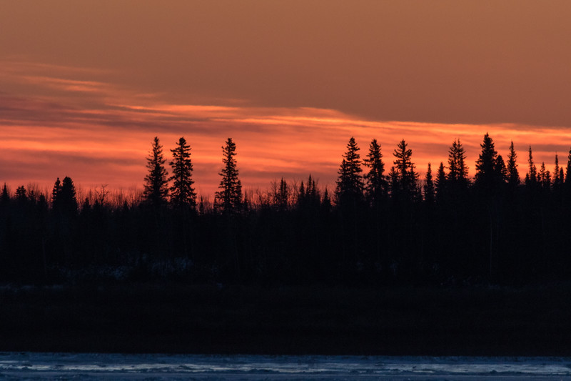 Looking across the Moose River from Moosonee before sunrise.