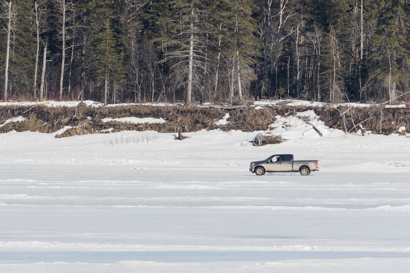Truck driving on the Moose River in front of Butler Island.