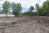 Cleared area at corner of Ferguson Road and Fourth Street in Moosonee 2017 June 24th. Looking towards backs of buildings on Revillon Road.