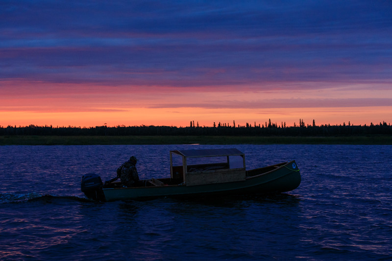 Robert Blueboy heads off in his taxi boat before sunrise.