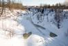 Store Creek looking from railway bridge towards Atim Road bridge. Snowmobile track and some slushy areas.