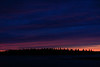 Thin band of pink over Butler Island before sunrise.