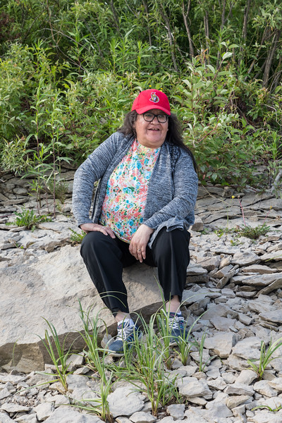 Denise Lantz sitting near mouth of Store Creek.