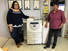 Kathryn Hookimawillene and Celine Koostachin with new 8030 photocopier.