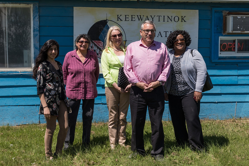 Ontario Housing Minister Chris Ballard at Keewaytinok Native Legal Services in Moosonee with Articling Student Ruchi Punjabi, Interpreter Celine Koostachin, Assistant Deputy Minister Karen Glass and Advisor Camille Gooden.