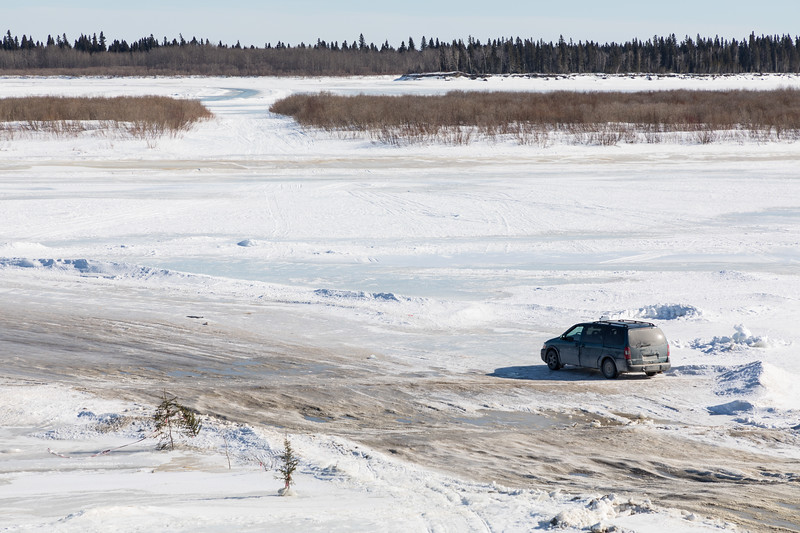 Moosonee taxi waiting at the bottom of McCauley's Hill for vehicle from Moose Factory. Moose Factory vehicles without insurance or plates cannot drive in Moosonee.