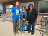 Jeff Schlemmer and Monica Wolf from Neighbourhood Legal Services in London with Denise Lantz outside Northern Store in Moosonee.