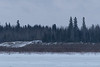 View across the Moose River from Moosonee on an overcast morning to road going up onto Moose Factory Island. 2017 March 27th.