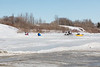 Sledders and snowmobile at base of McCauley's Hill.